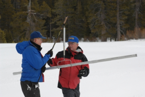 Snowpack surveys like the one pictured in this file photo are taking place to determine snow levelsa and the impact on the drought.