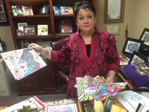 Hildy Carrillo, executive director of the Calexico Chamber of Commerce, shows some of the artwork that is such a critical part of her life.